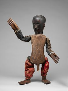 Puppet (Si Gale-gale) Date: late 19th–early 20th century Geography: Indonesia, Sumatra Culture: Toba Batak people Medium: Wood, cloth, metal, pigment Dimensions: H: 21 1/2 in. (54.6 cm) Classification: Wood-Sculpture Credit Line: Gift of Fred and Rita Richman, 1988 Accession Number: 1988.143.47 This artwork is currently on display in Gallery 355