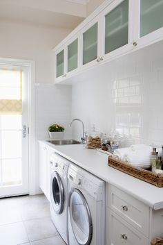 Walk through mudroom and laundry room. All white laundry room with sink, white subway tiles, and glass upper cabinets. Beautifully styled with tray of soaps and hand towels. Mudroom Laundry Room, Laundry In Bathroom, Laundry Area, Laundry Decor, Laundry Room Inspiration, Small Laundry, Small Sink, Laundry Room Design, New Homes