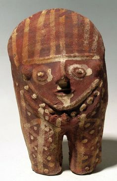 An excellent Chancay figure from Peru, c. 1000 - 1200 AD.  This elaborately decorated Huacho style male is 7-1/2 in high and is adorned with the typical striped headdress and complex designs on the body and legs which represent clothing, jewelry and body decor.  Good paint, strong mineral deposits.