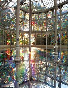 greenhouse I view this as stain glass with color and yet let's in the bright sun to color the water below to paint our world as a painter's brush on his canvas. Joyce P.