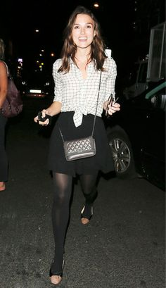 Keira Knightley completes her casual chic black-and-white look with a smile. #style