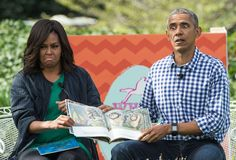 TOPSHOT - US President Barack Obama and First Lady Michelle Obama read Maurice Sendak's 'Where the W... - Nicholas Kamm/AFP/Getty Images