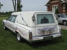 1990 Custom Cadillac Fleetwood Brougham: 12/27/2014 Toronto, Ontario, Canada - This hearse has seen her share of car shows and swap meets.  Airbrushing as well as skulls and gargoyles.  Coachbuilder