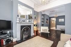 Period features with modern furnishings & decor, dark wood floor, grey walls (paint - Plummett from Farrow & Ball)