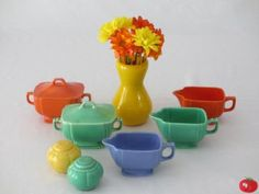 This is some of my Riviera collection, a red sugar and creamer, a green sugar and creamer, a mauve creamer (I'm still looking for that mauve sugar bowl) and yellow and green salt and pepper shakers.