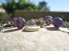 Lucky gems bracelet with amethyst and wisdom token