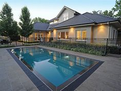Awesome Black Colored Pool Fence Ideas Made From Metal Near Small Blue Pool