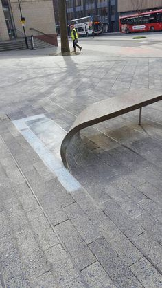 This bench is made from a curled-up paving stone.