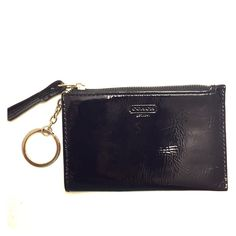 Coach Coin Purse Authentic Coach black patent leather zippered coin purse with silver key ring. Card slot on back face. Light scuffs on exterior with very small blemish on back card slot. Otherwise in very nice condition! Used only a few times. Coach Accessories Key & Card Holders
