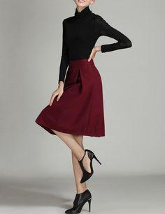Burgundy high waist midi skirt with a wool feel. Size Available :S,M,L Length(cm) :S:63cm,M:64cm,L:65cm Waist Size(cm) :S:61cm,M:65cm,L:69cm Belt :NO Fabric :Fabric has no stretch Season :Winter Patte