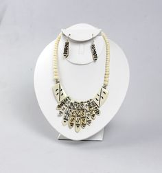 """Bead strand leads to Pointed pendants increasing in size hang from the middle. Earrings pointed pendants hang directly from hooks. Made in India. 1"""" earrings. 19"""" long. Click on the link to see more: africaimports.com"""
