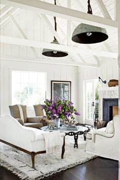 Gorgeous white living room with board and batten