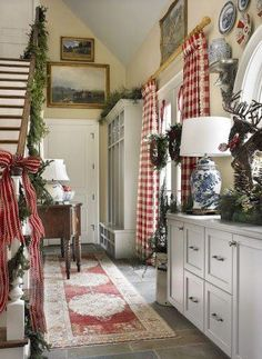 I like the actual cabinetry and stairs not just the Plaid Christmas again love the curtains