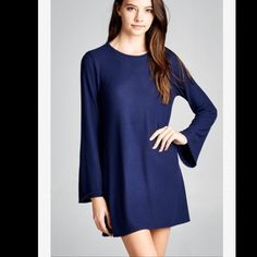 Long Bell Sleeve Dress Long fit,long bell sleeves,round neck dress. This dress is made with medium weight brushed knit fabric that has a very soft fuzzy texture,drapes well and is very warm. This fabric has great stretch as well. Material--62% polyester,33% Rayon,5% spandex. Available in small,medium,large Dresses Midi