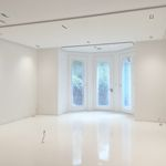 Stunning reflective white gloss seamless resin floor in apartment. Suitable for domestic or commercial. UV stable self-smoothing polyurethane screed with high gloss finish.