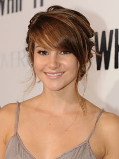 Soft, sideswept bangs with an updo, this is my wedding style, then I may switch it up ;p