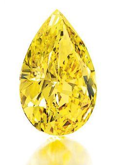 Rare 32.77 Carat Fancy Vivid Yellow Diamond