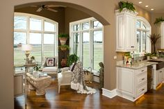 Sunroom off of the kitchen. Courtesy of Schumacher Homes.