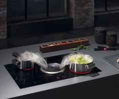 The Bora Basic system consists of a powerful induction hob combined with an efficient extractor placed at the centre of the worktop consisting of two silent extractors