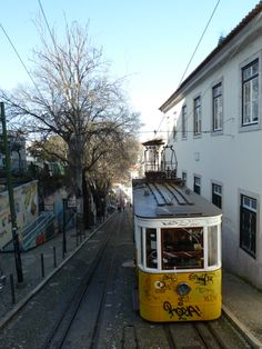 Funicular going up and down the highest hill of Lisbon.