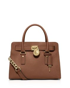 Gleaming hardware and structured saffiano leather give Michael Michael Kors' signature Hamilton satchel a rich elegance that you'll love for work, weekends, and everywhere in between.   Saffiano leath