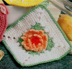 Flower Potholders Crochet Pattern Includes 6 potholder patterns: Stunning Sunflower, Ruffled Carnation, Iris, Geranium, Rosebud Wreath and Waterlily. Vintage potholder crochet pattern for your kitchen