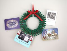Christmas card wreath tutorial - Give your fridge a break and display your cards with this homemade wreath craft. Construct one using clothespins and a hanger.