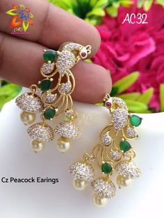 Stunning 1 gram gold earrings in dancing peacock desig. Earrings studded with pink green and white color CZs. Gold Jhumka Earrings, Jewelry Design Earrings, Gold Earrings Designs, Peacock Earrings, Fancy Jewellery, Silver Jewellery Indian, Gold Jewellery Design, Gold Jewelry Simple, Schmuck Design