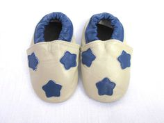 Dallas Cowboys!!! Blue stars on a tan leather soft baby shoes with matching tan banding.