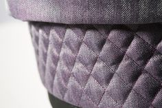 The stylish Sleepover design features premium woven herringbone fabrics and quilted detailing