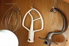 organize kitchen aid accessories with command hooks, cleaning organization, kitchen design, Make sure to do this on an inside wall or it will swing every time you open or close the cupboard Kitchen Organization, Organization Hacks, Kitchen Storage, Organized Kitchen, Organization Ideas, Mixer Accessories, Kitchen Accessories, Kitchen Hacks, Kitchen Decor