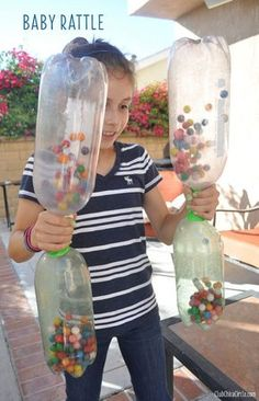 Baby Rattle as a 15 Minute to Win It Party Game. Player must shake gumballs from an empty 2 liter bottle into the other bottle on the bottom.