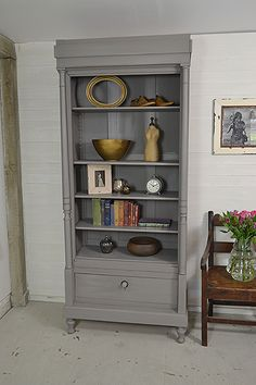 We adore this tall slimline French bookcase as it's perfect for an alcove or smaller space. We've painted in Farrow & Ball Mole's Breath and lightly distressed. #frenchfurniture #frenchshabbychic #shabbychicfurniture https://www.thetreasuretrove.co.uk/cabinets-and-storage/tall-slimline-shabby-chic-french-bookcase