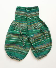 Green striped funky baby baggy trousers. Fit ages 6 months to 16 months.  http://naggarvalley.com