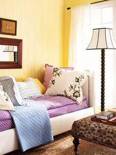 Small Bedroom Solutions-  Stunning Stripes      Space Saver: Use vertical stripes to draw the eye toward the ceiling and make the room seem instantly larger.        Drawing the eye upward is an age-old trick for making a small room feel larger. Vertical striped wallpaper does the job in this bedroom. You can also make a ceiling seem higher by hanging curtains above the top of the window frame.