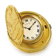CARTIER A FINE 18K YELLOW GOLD COIN WATCH CIRCA 1930