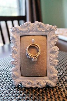 DIY: Ring Holder Frame…great by the kitchen sink  (Antonia- My Mum is always throwing hers in the cutlery drawer, I put mine (engagement ring) on the drawers next to my bed or by the sink when washing up lol)