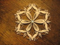 Quilled filigree snowflake. via Etsy.