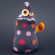Adore these sock monsters by Pat Mayer - and the proceeds go to a good cause, too!