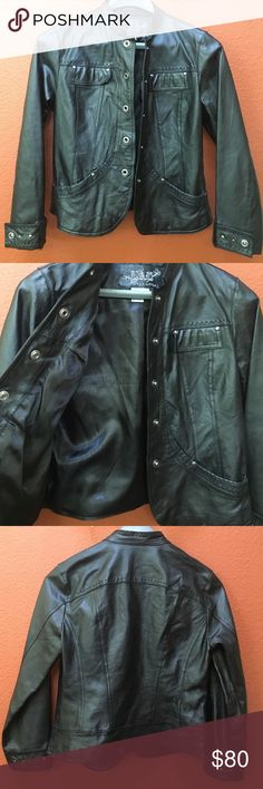 """Moto Rockstar Black Studded 100% Leather Jacket Smokin hot jacket, fits like a glove! So many compliments, personal favorite worn only a few times, immaculate condition, but time to part❤️ 100% Leather shell, 100% Polyester lining. Cool cross-stitching patterns, silver hardware throughout, studded pockets and sleeves. The brand is """"Live A Little"""" (Nordstrom brand), size Medium (true to size). The jacket looks new, no signs of wear, absolute beauty! Make me an offer or email me…"""