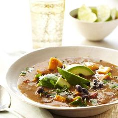 This vibrant soup is loaded with sweet potato chunks, filling black beans, and fresh avocado slices.