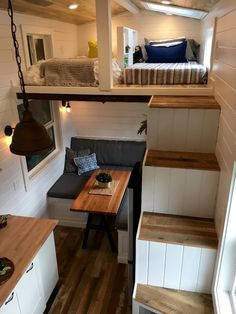 The Rocky Mountain Tiny Home features a double storage staircase that leads to the two sleeping...