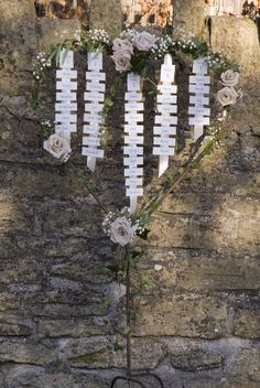 Seating Plan - metal heart stand decorated with wedding flowers. www.thelilylocket.co.uk