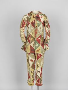 Harlequin's costume, wool embroidered with wool and silk and lined with cotton and linen/hemp blend, 18th century. (Photograph links to jacket, link to trousers here: http://objektkatalog.gnm.de/objekt/T1926)