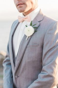 sophisticated, sharp grey suit with pastel peach bowtie and white floral boutonniere - photo by B. Jones Photography