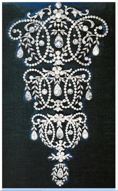 In 1920, Queen Mary had Garrards design a diamond and pearl stomacher.  This stomacher has remained in the Royal Collection and has been worn as originally intended:  a collection of three broaches.  The exquisite workmanship is typical of the standard demanded by Queen Mary for her jewels.  Queen Mary gave it to the Queen as a wedding gift in 1943.