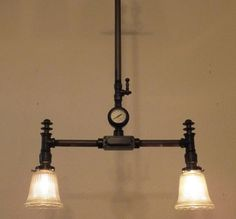 Steampunk lamp vintage industrial light chandelier machine age edison bulb antique steam punk. $425.00, via Etsy.