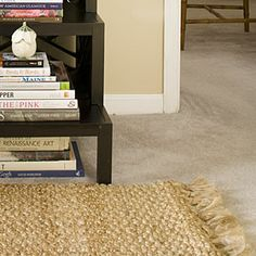 Apartment Decorating Layer Rugs Over Carpet 10
