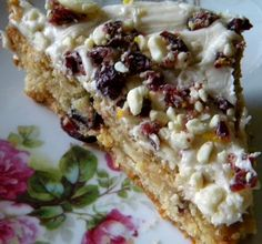 Copycat Cranberry Bliss Bars  -  A great bar to celebrate the holidays along side those delicious cookies and brownies you are making.