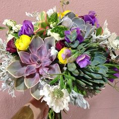 Succulent bridal bouquet with charming accents...